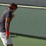 Tommy Haas tries to nail Roger Federer